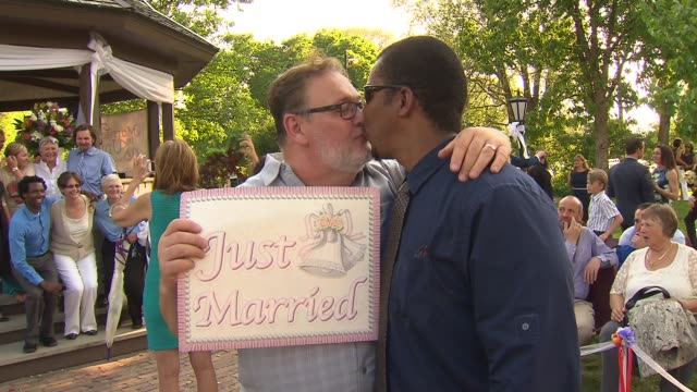 WGN Samesex couple gathered to get married at Unity in Chicago church when Illinois' marriage equality law went into effect statewide on June 1 2014
