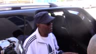 Samuel L Jackson greets fans while arriving at LAX Airport in Los Angeles in Celebrity Sightings in Los Angeles