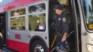 San Francisco police officers exit a bus at Alamo Square in San Francisco California where protesters gathered after members of Patriot Prayer an...