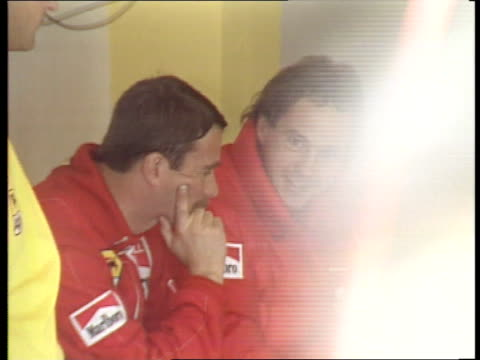 San Marino Grand Prix Crash Escape **** FOR ITALY Imola Nigel Mansell chatting with Gerhard Berger before start of race Mansell in Ferrari
