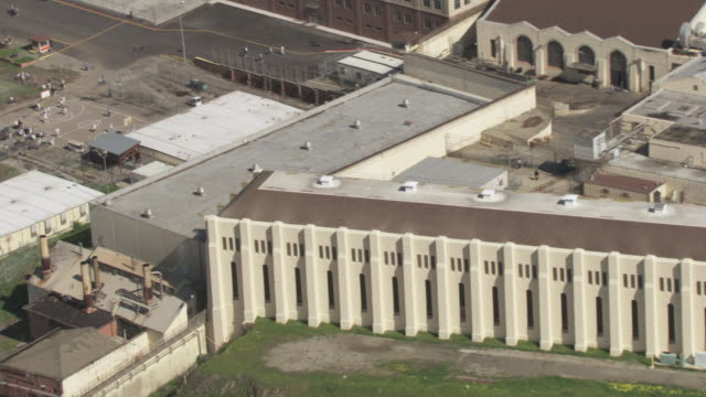 AERIAL San Quentin State Prison with inmates on the grounds engaging in outdoor activities / San Quentin, California, United States