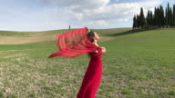 San Quirico d'Orcia, Orcia valley, Siena, Tuscany. Girl admires the view near the cypresses of Val d'Orcia