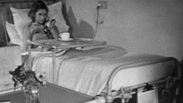 1943 PAN Sanatorium's long exterior deck area and patient's open doors to convalescing patients in their rooms / United Kingdom