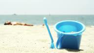 Sand bucket on the beach