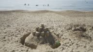 Sand castles on the beach.