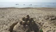 Sand castles on the beach.