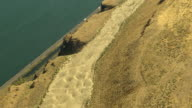 MS AERIAL Sand dunes on cliff with Columbia River and highway below at Columbia River Gorge / Oregon, United States