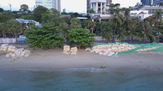 Sandbags protect erosion along the Pattaya beach, Chonburi, Thailand.