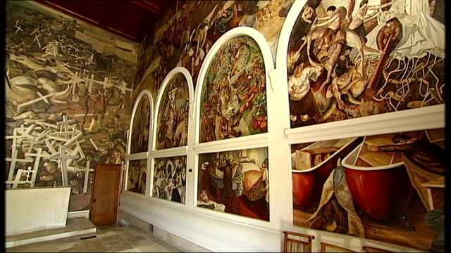 Sandham Memorial Chapel and Stanley Spencer WW1 murals reopen to public INT PAN World War One murals painted by Stanley Spencer Various shots details...