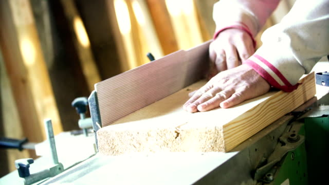 Sanding a piece of wood.