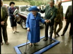Queen Mother attends 1730 LIBBY ENGLAND Sandown Park EXT Queen Mother stepping onto disinfectant mat on arrival at Sandown Park racecourse Queen...