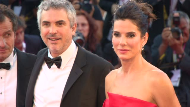 Sandra Bullock George Clooney Alfonso Cuaron and Jonas Cuaron at Opening Ceremony/'Gravity' Red Carpet on August 27 2013 in Venice Italy