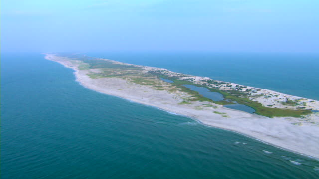 A sandy peninsula reaches out into the ocean along the Gulf Islands National Seashore in Mississippi.