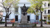 Santa Clara, Cuba: City lifestyle in the morning around the Marta Abreu bronze statue. She is known as the benefactress of the city