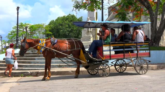 Santa Clara, Cuba: Horse-drawn carts acting as urban transportation vehicles
