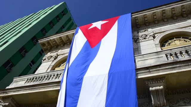 Santa Clara, Cuba: Large Cuban National Flag hanging on the old buildings of the Leoncio Vidal park