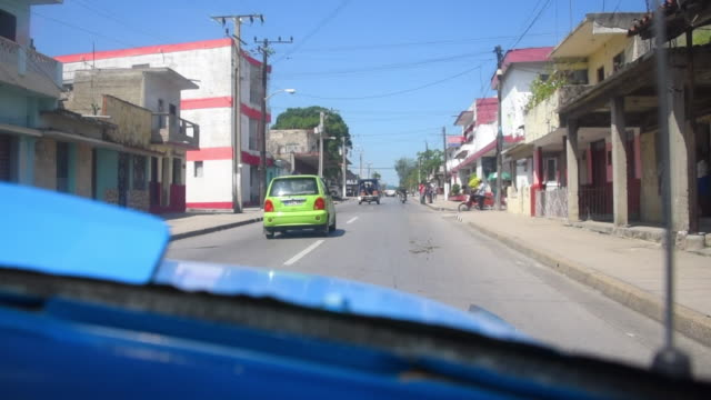 Santa Clara, Cuba: Old vintage car driving in the Central Road, point of view image
