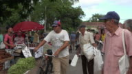 Santa Clara, Cuba: The 'Sandino' Sunday Farmer's Market, real people walking by the stands selling food