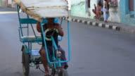 Santa Clara, Cuba: traditional  'bicitaxi'  or rickshaw for urban transportation in the 'Colon' street