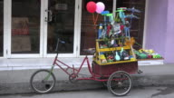 Santa Clara, Cuba: Tricycle full of homemade toys for sale in the city streets.