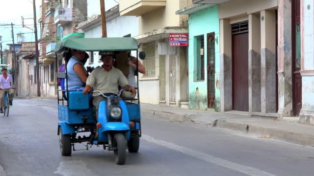 Santa Clara, Cuba: urban transportation using 'motonetas' and other vehicles