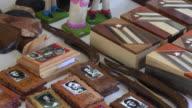 Santa Clara,Cuba: Selling handmade tourist souvenirs in the Leoncio Vidal park or plaza