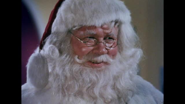 Santa Claus says, 'I'll try dear lady, I'll try'