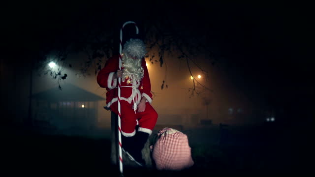 Santa Claus swinging on a swing, night, sack with gifts, stick, tree, chrismtas, gift, city,