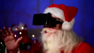Santa Claus using a virtual reality headet
