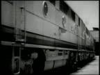 Santa Fe trains in yard Barstow California VS Diesel train passing taking turn on railroad tracks on mountainous bend train on mountain side INT VS...