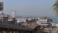 HA Santa Monica Pier amusement park, with still Ferris wheel / Santa Monica, California, United States