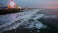 Santa Monica Pier and beach at dusk in Santa Monica, California