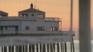 MS Santa Monica Pier and volleyball net at dusk / Santa Monica, California, United States