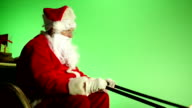 Santa sat in Sleigh with Green screen from side