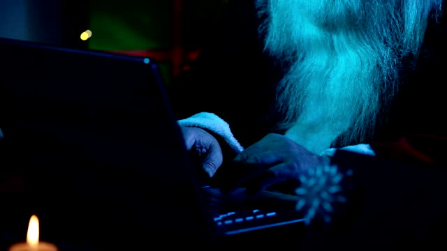Santa uses a laptop in the moonlight