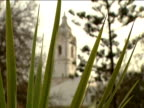 Santo Antonio Church with long grass in foreground pull focus to church