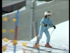 Sarah Ferguson backgrounder ITN LIB Klosters MS Sarah wearing light blue ski suit white fur headband skiing down slope LR CMS Sarah PULL OUT as...