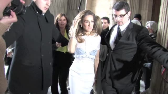 Sarah Jessica Parker leaves the Louis Vuitton Fashion Show in Paris with a massive crowd of Photographers following her Sarah Jessica Parker leaving...