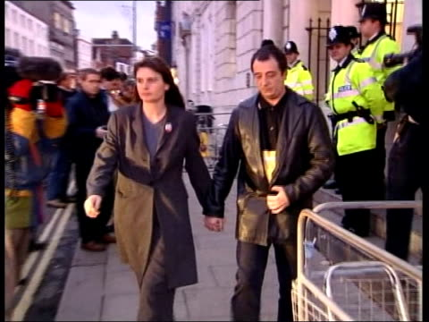 Sarah Payne murder trial continues MS Sara and Michael Payne out of court and away PULL OUT Texaco garage NIGHT MS Police van away from court PAN to...
