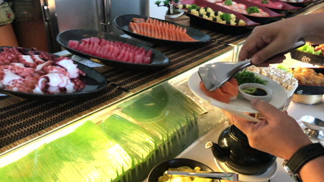 Sashimi bar , gripping salmon and giant octopus, Bangkok , Thailand