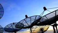 satellite dish under sky at twilight