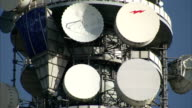 Satellite dishes are positioned near an observation window on the BT Tower. Available in HD.