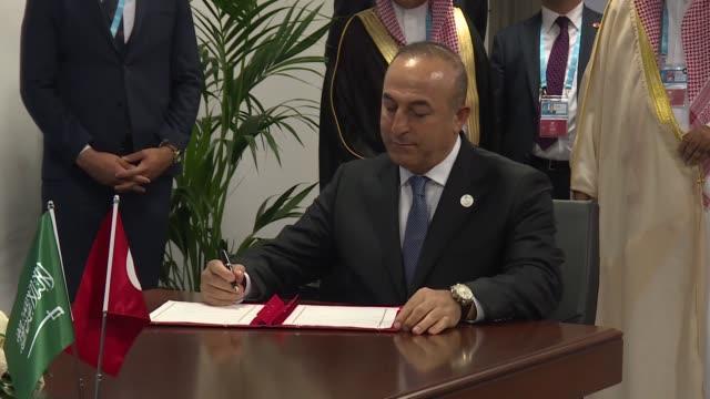 Saudi King Salman bin Abdulaziz Al Saud and Turkish President Recep Tayyip Erdogan attend a signing ceremony of an agreement on the establishment of...