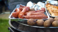 Sausage and steak on barbecue grill