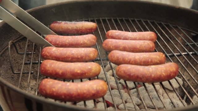 CU Sausages being grilled over charcoal / Portland, Oregon, United States