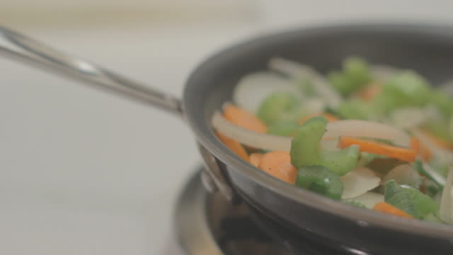 Sauteeing Mixed Veggies in a pan mixed with stirrer