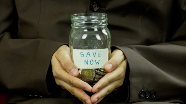 Save money for investment concept money in the glass jar