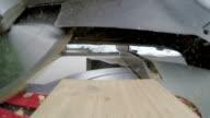 Sawing at board at a 45 degree angle