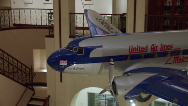 MS PAN Scale model airplane United Air Lines DC-3 hanging from ceiling in SFO Museum
