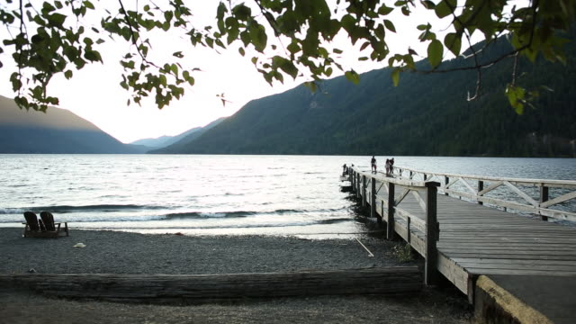 A scene from Lake Crescent in Olympic National Park at sunset on a warm summer evening.